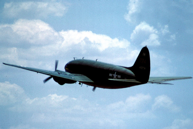 Curtiss C-46F Commando [1944] N78774 (s/n 44-78774) Confederate Air Force Airshow, Denton, Texas - June 1984  <i>The Tinker Belle</i> in flight.