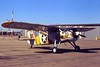 """Fairchild UC-61 Forwarder [1941] N46614 (s/n 41-38808)<br /> Oxnard Airport, Oxnard, California - December 1972<br /> <br /> Although listed in the FAA Registry as a Fairchild 24W-41A, this aircraft rolled out of the factory in 1941 as a UC-61 Forwarder, the military version of Fairchild's extremely popular Model 24. It was then slated to be transferred to the RAF as an Argus I (the British equivalent), but it was never delivered. It's seen here in painted in the color scheme of the North Africa campaign during """"Operation TORCH."""" The yellow border on the roundels helped Allied gunners identify friendly aircraft.<br /> <br /> This aircraft is powered by a 165-hp Warner Super Scarab radial engine. Production run for the 1941 UC-61 was 640 aircraft."""