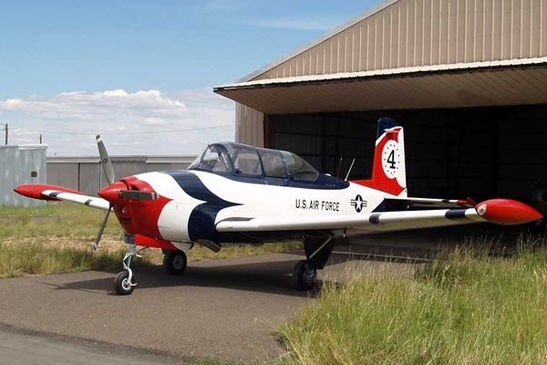 Beechcraft T-34A Mentor [1955] N9JD (s/n 53-3373)<br /> Casparis Airport, Alpine, Texas - August 2009<br /> <br /> Delivered to the USAF as serial number 53-3373 with construction number G-134, this aircraft was eventually stricken off charge and registered as N7PP to a Phil Pingleton of Kenedy, Texas. As N7PP, the aircraft was registered to its current owner, J.D. Daniel, in 1992, at which time it became N9JD. The aircraft was restored over a ten-year period by Longs Aircraft of Coleman, Texas, and was finished just in time to participate in Oshkosh 2009.<br /> <br /> N9JD is painted in the scheme of the USAF Thunderbirds, although it was never a Thunderbird itself. The aircraft is no longer in military service.