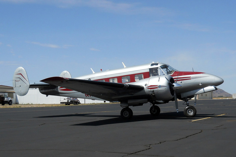 Beechcraft E18S [1959] N7MB<br /> Casparis Airport, Alpine, Texas - June 2014<br /> <br /> Originally produced in the standard taildragger configuration, it was later converted to tricycle gear. I don't know how it stays upright. That's a lot of tail behind the main wheels.