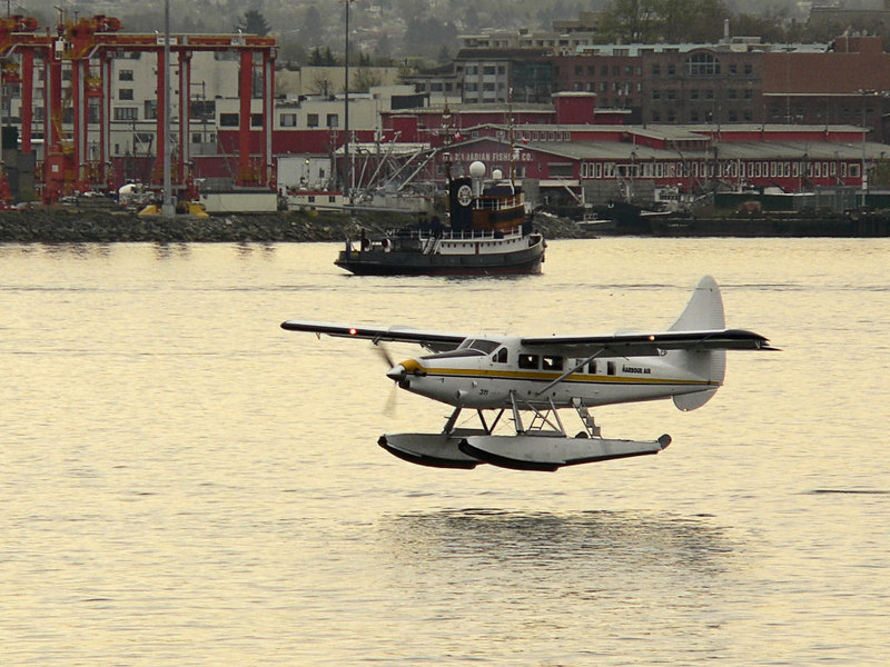Another Turbo-Otter taking off from Vancouver Harbour.  The tug in the background is a restored old timer used for tours and possibly week long fishing and coastal expeditions.