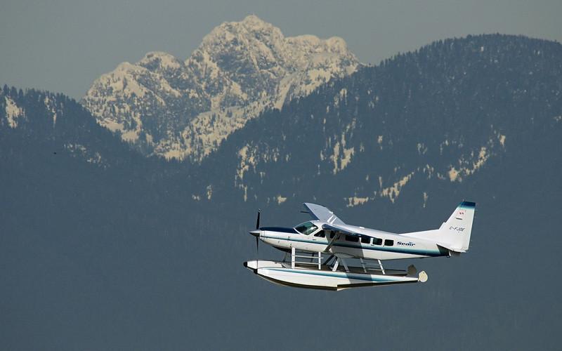 Seair C-FJOE - Cessna 208 Caravan I<br /> Departing from floatplane base on south side of YVR.
