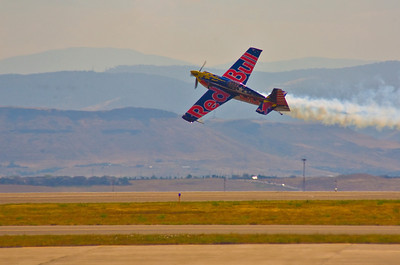 Kirby Chambliss in his Zivko Edge 540 performing a knife-edge pass