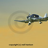 light wood frame 4 seater aircraft. Flying out of the sunset
