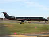 Dale Earnhardt Inc. EMB-145 taxies after landing at FRG.  The jet brought team members to the NASCAR Nextel Cup Banquet in NYC.