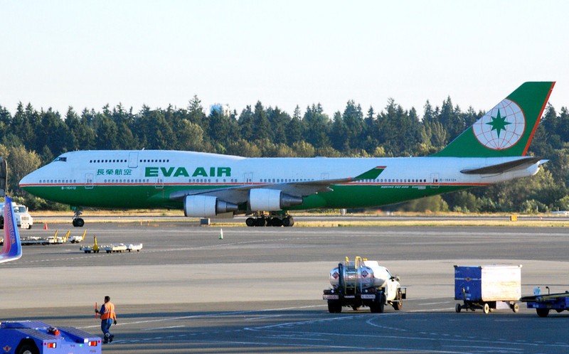 "EVA Air 747-400 - Sea-Tac (KSEA) Airport - Taken from terminal while waiting for flight home to Charlotte. 7/13/2013; Not a high quality picture, but I included it here as a reminder of seeing this foreign carrier ""heavy""."