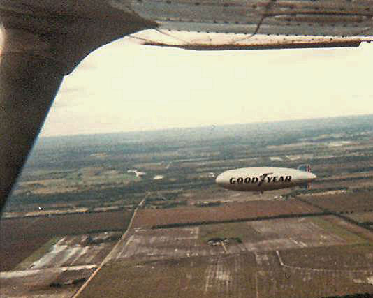 1986. I was out flying one day when the Goodyear Blimp wandered thru the area. Flew in loose formation with him for awhile and snapped some pictures of him with my Kodak 110 Pocket Instamatic camera.