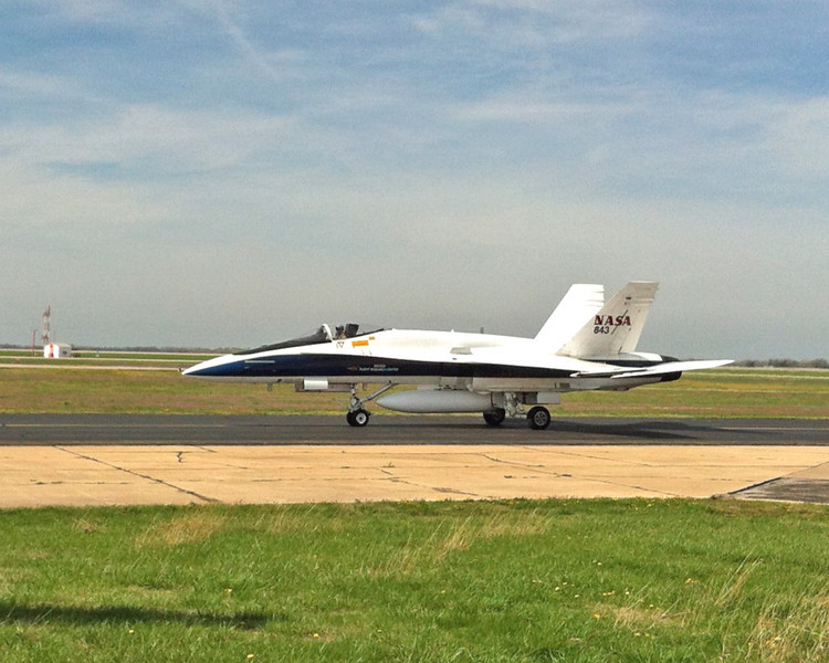 NASA F18 chase plane taxiing into Cessna Aircraft facility. Wichita Mid-Continent Airport, March 2012.