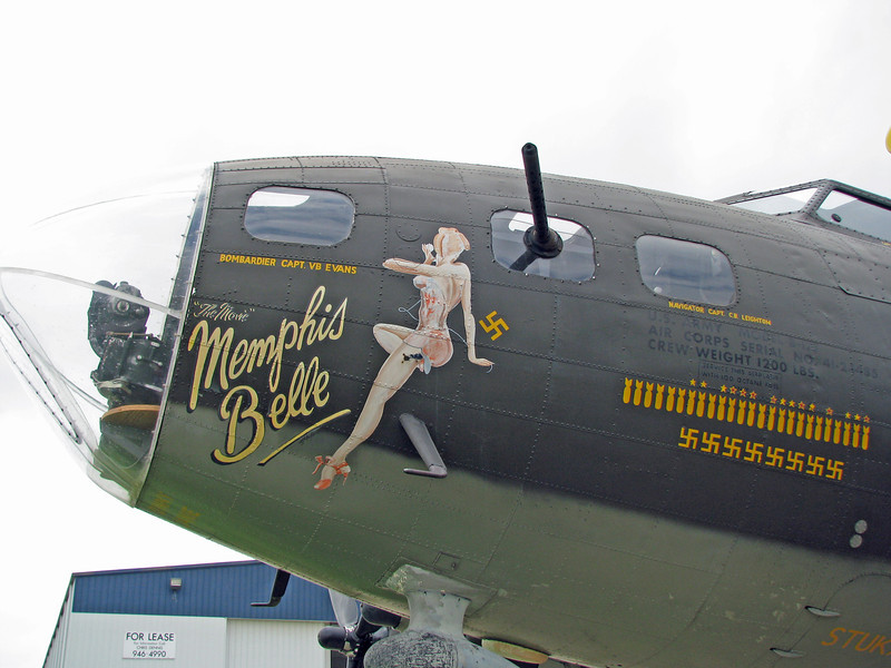 Left side nose art and bombardier gun. Bombing mission and gunner victories painted visible at right.