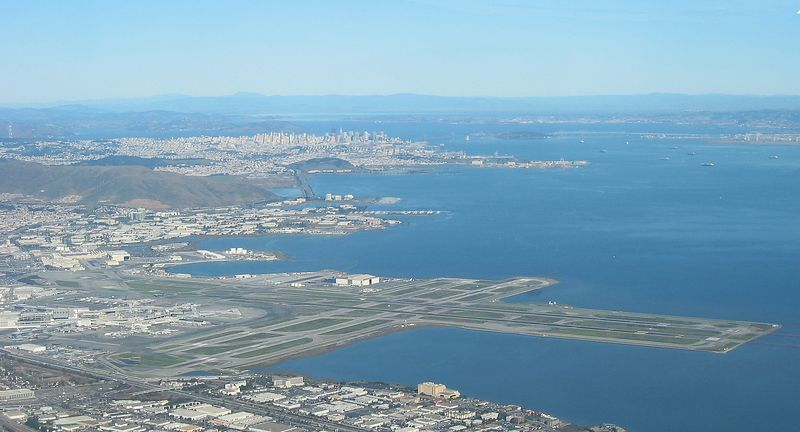 San Francisco International (SFO) in the foreground and the city of San Francisco in the background.
