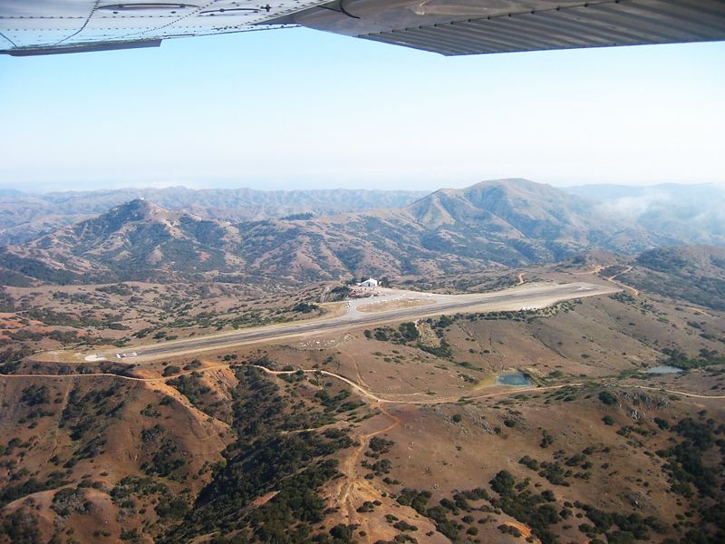 Catalina Airport (AVX) on Santa Catalina Island off the coast of Southern California. Image taken from a Cessna 172 on downwind for runway 22.