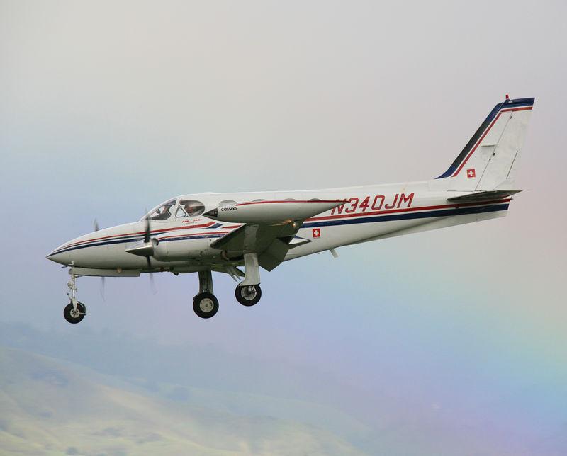 N340JM Cessna 340A landing at San Jose, California (KSJC). A rainbow in the background.