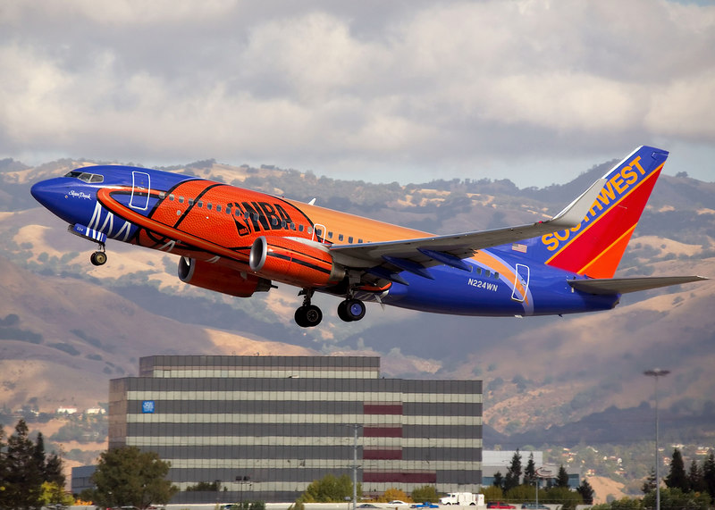 "Southwest Airlines Boeing 737, ""Slam Dunk"", on takeoff from San Jose International. Registration N224WN"