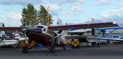 "A DeHavilland Otter with the original radial engine replaced by a turbine (otherwise known as a ""Turbo Otter"") being fueled along Lake Hood in Anchorage."