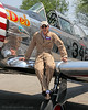 """""""Paul"""" , the pilot of the AT-6 Texan who's wing he is sitting on."""