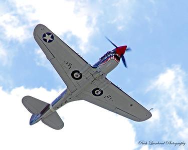 P-40 Warhawk overhead.