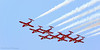 """Canadian """"Snowbirds"""" precision flying team on low pass flyby."""
