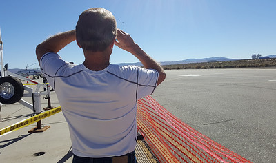 Proud father of VX-9 pilot is closely watching the fly-by of his son.