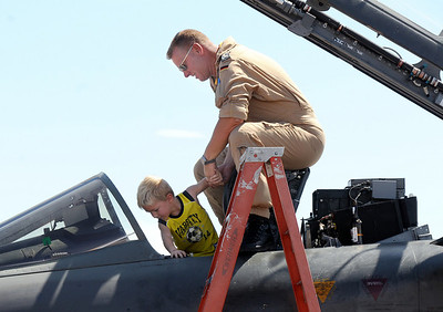 Pilot Axel Hoppe of the German Air Force helps Reed Lellbach, 5, of Westminster, into the cockpit of his Tornado fighter during Saturday's Colorado Sport International Airshow at Rocky Mountain Metropolitan Airport. August 28, 2010 staff photo/David R. Jennings