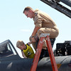 Pilot Axel Hoppe of the German Air Force helps Reed Lellbach, 5, of Westminster, into the cockpit of his Tornado fighter during Saturday's Colorado Sport International Airshow at Rocky Mountain Metropolitan Airport.<br /> August 28, 2010<br /> staff photo/David R. Jennings