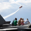 People watch a performance while sitting on the German Air Force Tornado aircraft during Saturday's Colorado Sport International Airshow at Rocky Mountain Metropolitan Airport.<br /> August 28, 2010<br /> staff photo/David R. Jennings