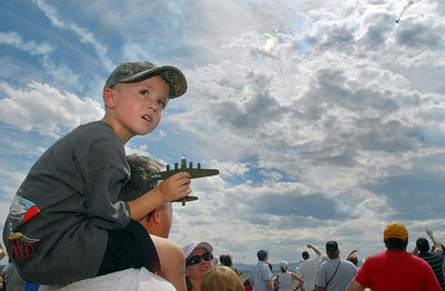 Thomas Perkins, 4, holds a model airplane while watching the airshow with his father Richard, of Broomfield, during Saturday's Colorado Sport International Airshow at Rocky Mountain Metropolitan Airport. August 28, 2010 staff photo/David R. Jennings
