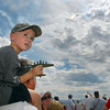 Thomas Perkins, 4, holds a model airplane while watching the airshow with his father Richard, of Broomfield, during Saturday's Colorado Sport International Airshow at Rocky Mountain Metropolitan Airport.<br /> August 28, 2010<br /> staff photo/David R. Jennings