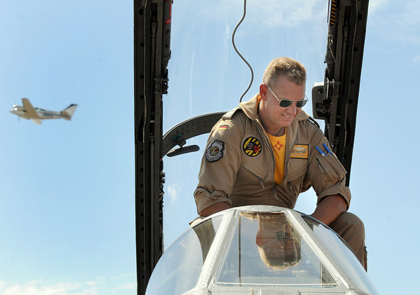 German Air Force pilot Axel Hoppe sits in the cockpit of his Tornado as an airplane flies by during Saturday's Colorado Sport International Airshow at Rocky Mountain Metropolitan Airport.<br /> August 28, 2010<br /> staff photo/David R. Jennings