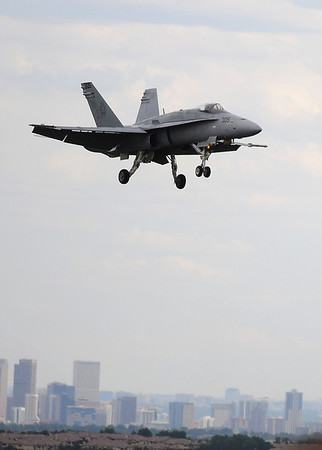 An F-18 with the West Coast Demo Team performs during Saturday's Colorado Sport International Airshow at Rocky Mountain Metropolitan Airport.<br /> August 28, 2010<br /> staff photo/David R. Jennings