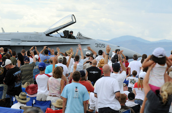 The crowd waves at the pilot of the F-18 after his performance during Saturday's Colorado Sport International Airshow at Rocky Mountain Metropolitan Airport.<br /> August 28, 2010<br /> staff photo/David R. Jennings