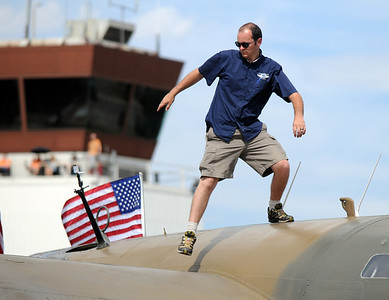 David Oliver with the Commemorative Air Force walks on the World War II B-24 bomber on display during Saturday's Colorado Sport International Airshow at Rocky Mountain Metropolitan Airport. August 28, 2010 staff photo/David R. Jennings