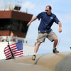 David Oliver with the Commemorative Air Force walks on the World War II B-24 bomber on display during Saturday's Colorado Sport International Airshow at Rocky Mountain Metropolitan Airport.<br /> August 28, 2010<br /> staff photo/David R. Jennings