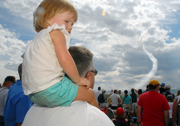 Susan Perkins, 19 months old, watches the airshow from the shoulders of her father, Thomas, during Saturday's Colorado Sport International Airshow at Rocky Mountain Metropolitan Airport.<br /> August 28, 2010<br /> staff photo/David R. Jennings