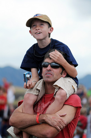 Shawn Wallace, 8, and his father Jack, of Denver, watch the F-18 demonstration during Saturday's Colorado Sport International Airshow at Rocky Mountain Metropolitan Airport.<br /> August 28, 2010<br /> staff photo/David R. Jennings