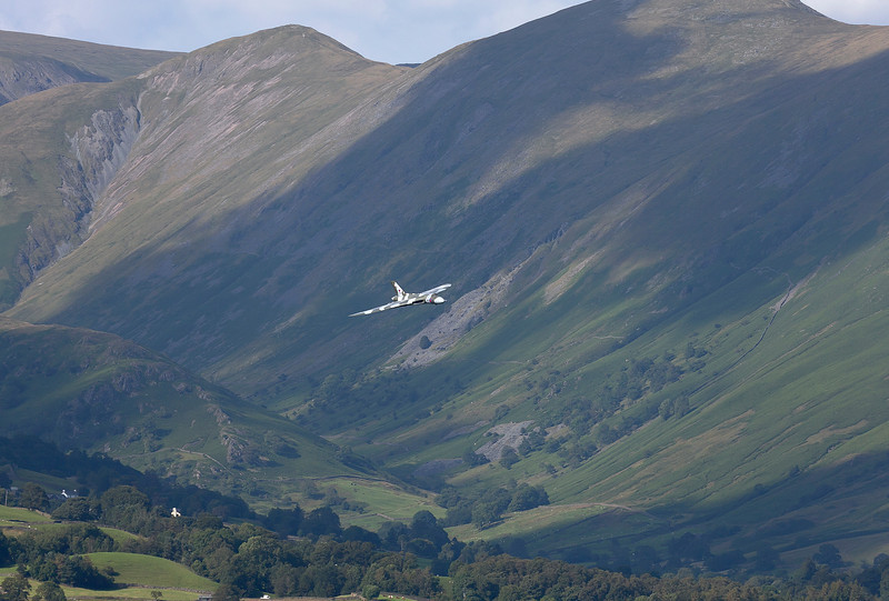 Even the mighty Vulcan bomber is dwarfed by the Cumbrian fells! XH558 on its run in to display at the Windermere airshow 2011.