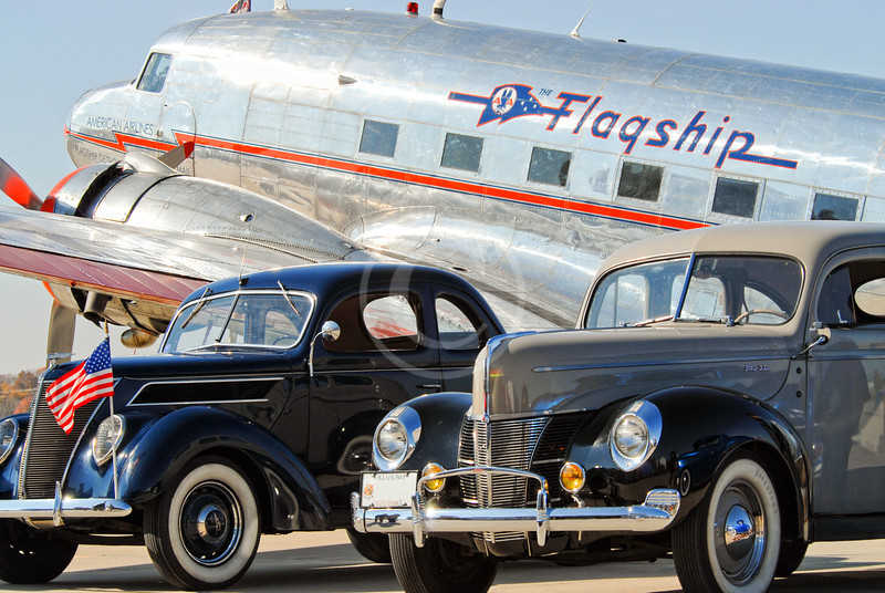 Vintage cars in front of the Flagship DC-3