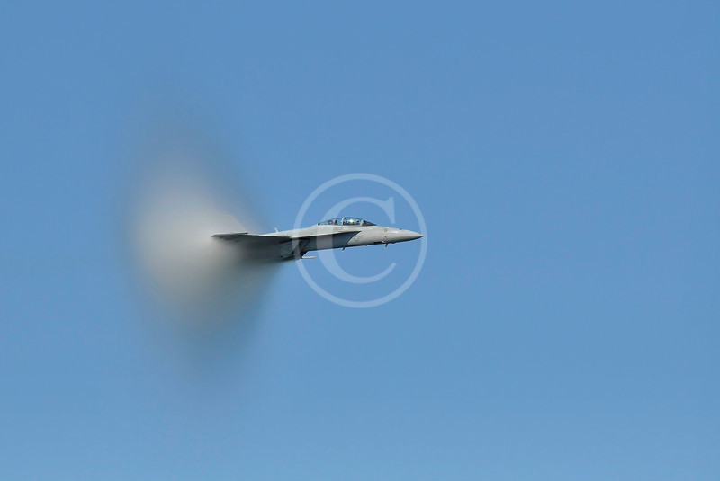 Military jet with vapor cone