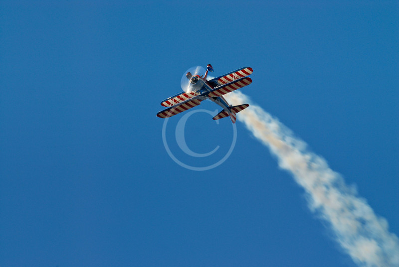 American Flag biplane with smoke