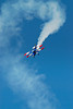 Red, white, and blue biplane