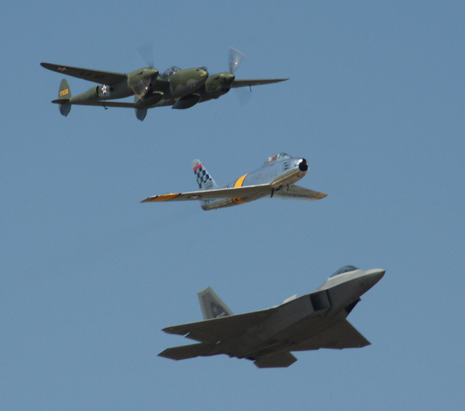 Heritage Flight.  P-38 Lightning, F-86 Sabre, & F-22 Raptor Stealth Fighter.