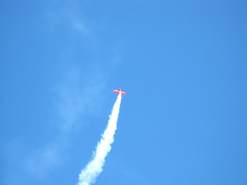 Sean D. Tucker doing his aerobatic routine in the Oracle Biplane.