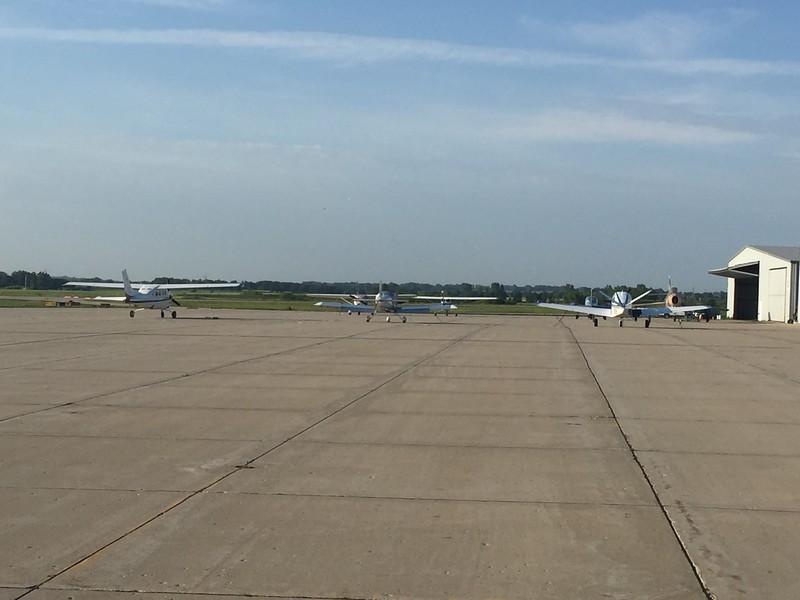 My little RV between a Cessna and Bonanza.