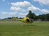 I went all the way south to the Ultralight field and saw lots of small helicopters flying around. This was a nice Rotorway Exec.