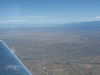Santa Fe Airport off the wing tip.