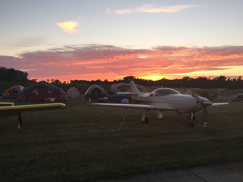 Lancair 360 with a sunset.