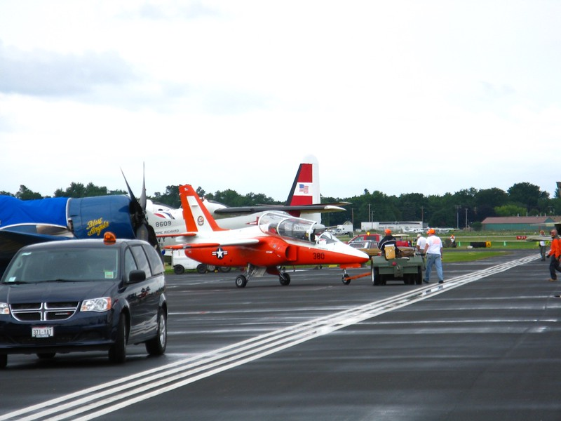 Siai Marchetti S-211 getting pushed back into parking spot.