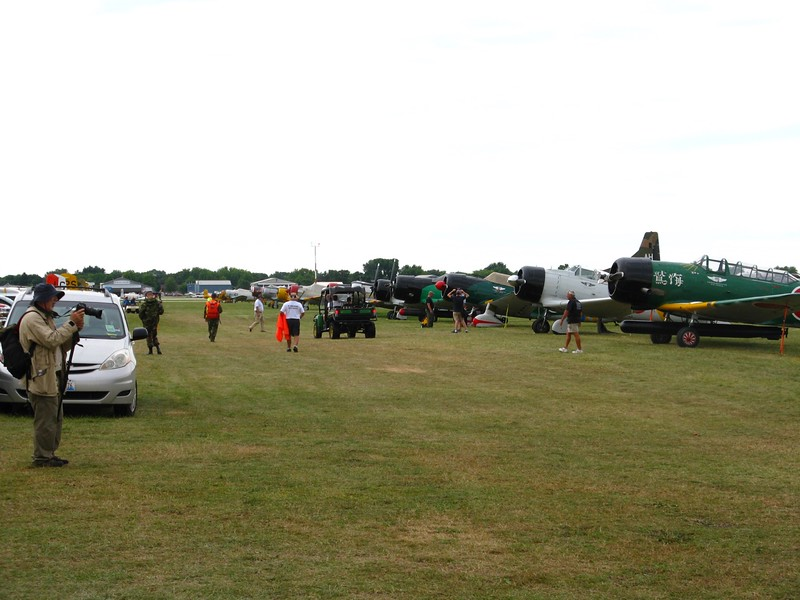 Huge number of warbirds on the grass.