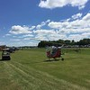 The ultralight runway was buzzing with small helicopters