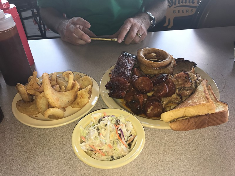 Homemade spiral cut fries, cole slaw, Texas toast, brisket, pulled pork, smoked hot sausage and a beef rib. Delicious!