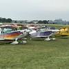 A line of Christensen Eagle biplanes. One in purple!